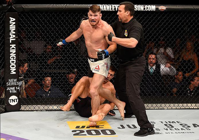 INGLEWOOD, CA - JUNE 04: Michael Bisping of England wins in a first round knockout against Luke Rockhold in their UFC middleweight championship bout during the UFC 199 event at The Forum on June 4, 2016 in Inglewood, California.  (Photo by Josh Hedges/Zuf
