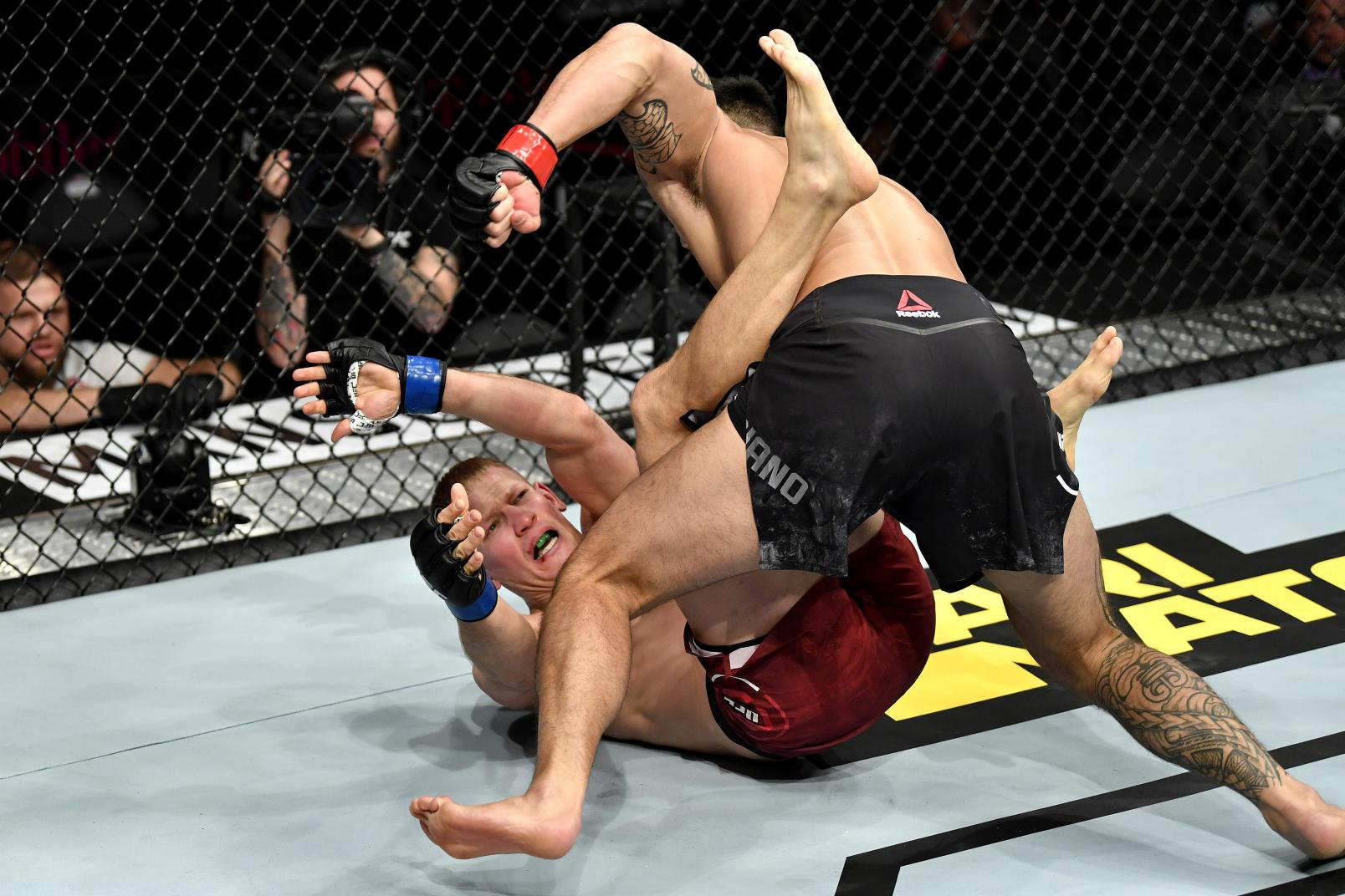 Punahele Soriano punches Oskar Piechota of Poland in their middleweight bout during the UFC 245.