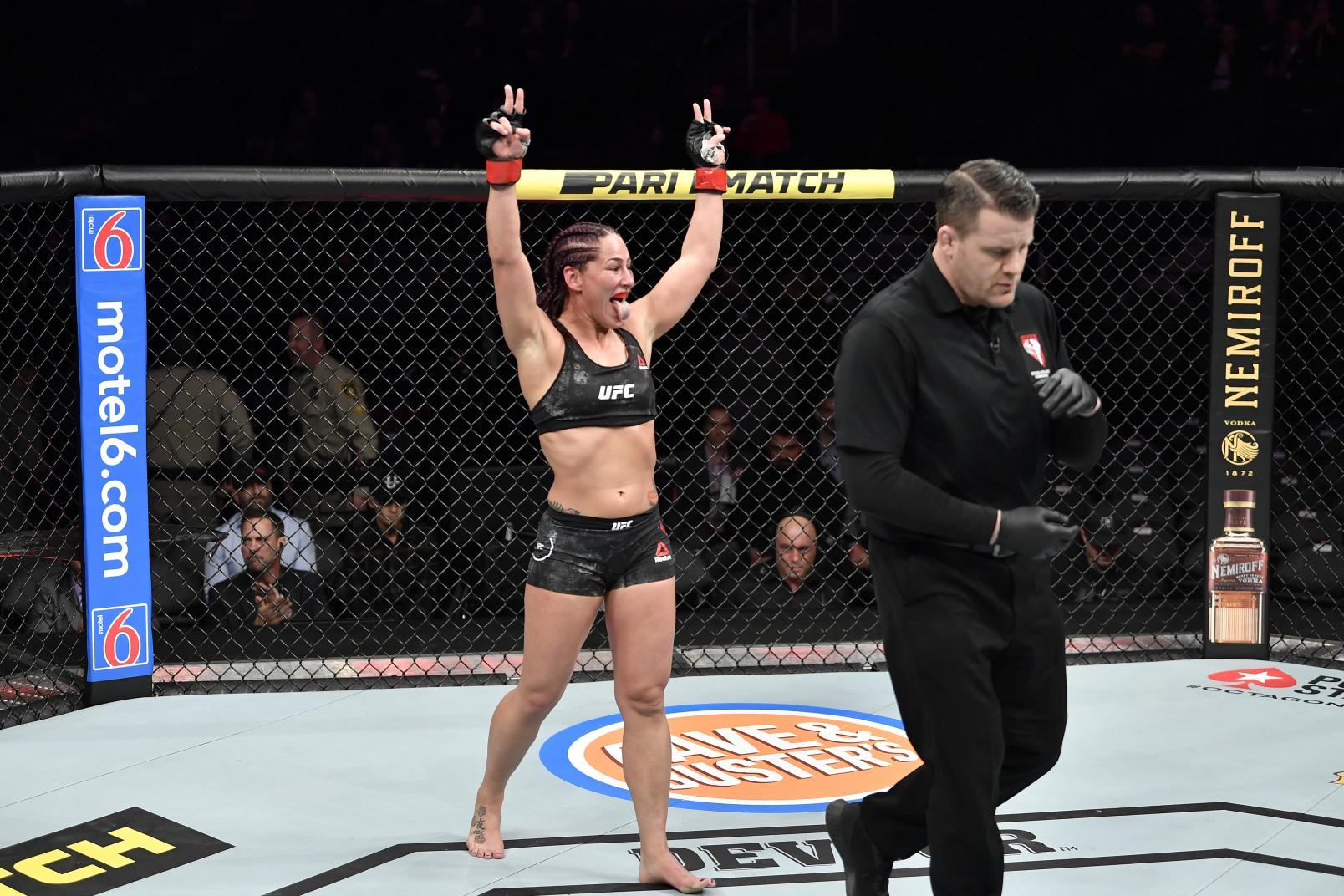 Jessica Eye celebrates the end of the round in her women's flyweight bout during the UFC 245.