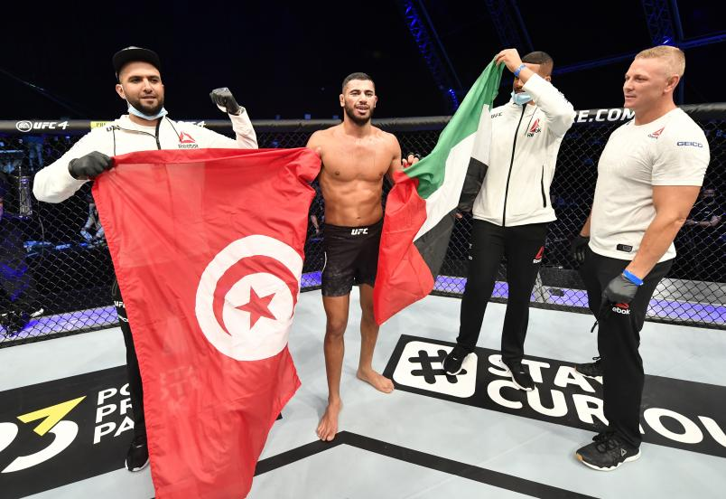 Mounir Lazzez celebrates after his unanimous-decision victory over Abdul Razak Alhassan in their welterweight fight during the UFC Fight Night event inside Flash Forum on UFC Fight Island on July 16, 2020 in Yas Island, Abu Dhabi, United Arab Emirates. (Photo by Jeff Bottari/Zuffa)