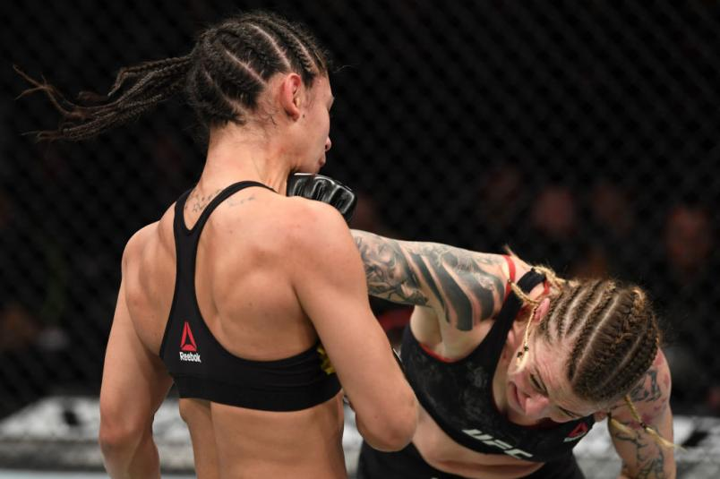 NEW YORK, NY - JANUARY 19: (R-L) Joanne Calderwood of Scotland punches Ariane Lipski of Brazil in their women's flyweight bout during the UFC Fight Night event at the Barclays Center on January 19, 2019 in the Brooklyn borough of New York City. (Photo by Josh Hedges/Zuffa LLC/Zuffa LLC via Getty Images)