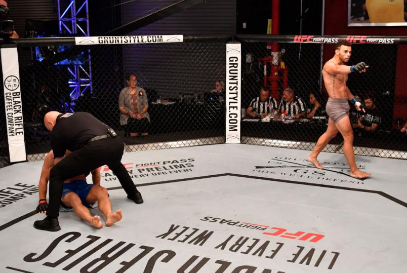 LAS VEGAS, NV - JUNE 26: Te Edwards celebrates after knocking out Austin Tweedy in their lightweight bout during Dana White's Tuesday Night Contender Series at the TUF Gym on June 26, 2018 in Las Vegas, Nevada. (Photo by Jeff Bottari/DWTNCS LLC)