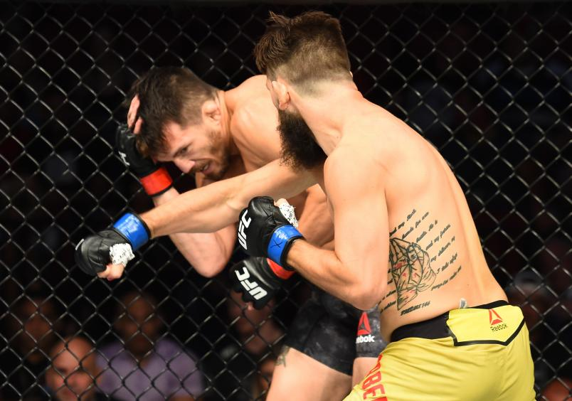 LINCOLN, NE - AUGUST 25: (R-L) Bryan Barberena punches Jake Ellenberger in their welterweight fight during the UFC Fight Night event at Pinnacle Bank Arena on August 25, 2018 in Lincoln, Nebraska. (Photo by Josh Hedges/Zuffa LLC/Zuffa LLC via Getty Images)