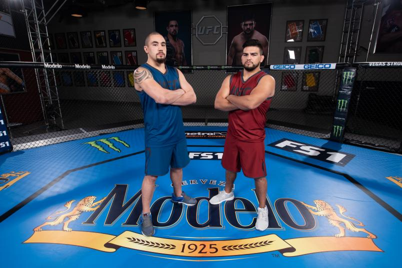 LAS VEGAS, NV - JULY 13: (L-R) Robert Whittaker and Kelvin Gastelum pose for a portrait during the filming of The Ultimate Fighter: Heavy Hitters on July 13, 2018 in Las Vegas, Nevada. (Photo by Jeff Bottari/Zuffa LLC/Zuffa LLC via Getty Images)