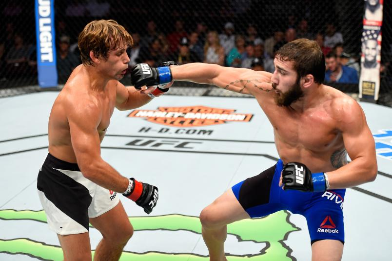 CLEVELAND, OH - SEPTEMBER 10: (R-L) Jimmie Rivera punches Urijah Faber in their bantamweight bout during the UFC 203 event at Quicken Loans Arena on September 10, 2016 in Cleveland, Ohio. (Photo by Josh Hedges/Zuffa LLC/Zuffa LLC via Getty Images)