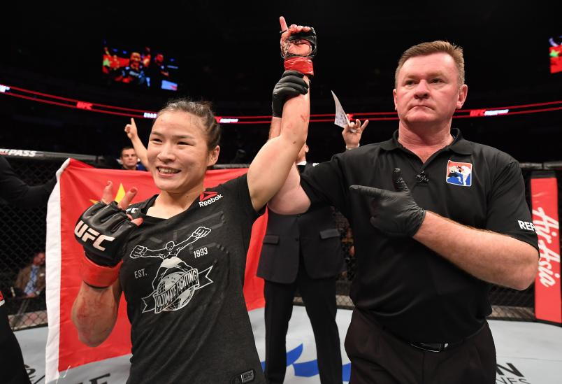 BEIJING, CHINA - NOVEMBER 24: Weili Zhang of China celebrates after her submission victory over Jessica Aguilar in their women's strawweight bout during the UFC Fight Night event inside Cadillac Arena on November 24, 2018 in Beijing, China. (Photo by Jeff Bottari/Zuffa LLC/Zuffa LLC via Getty Images)