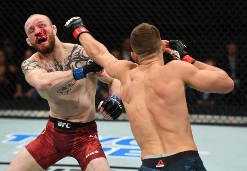 Calvin Kattar punches Chris Fishgold of England in their featherweight bout during the UFC Fight Night event inside Avenir Centre on October 27, 2018 in Moncton, New Brunswick, Canada. (Photo by Jeff Bottari/Zuffa LLC)