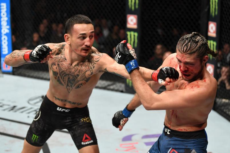 Max Holloway punches Brian Ortega in their UFC featherweight championship fight during the UFC 231 event at Scotiabank Arena on December 8, 2018 in Toronto, Canada. (Photo by Josh Hedges/Zuffa LLC/Zuffa LLC via Getty Images)