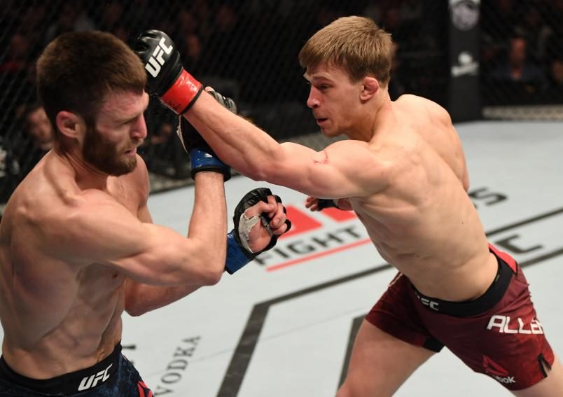 LONDON, ENGLAND - MARCH 16: (R-L) Arnold Allen of England punches Jordan Rinaldi in their featherweight bout during the UFC Fight Night event at The O2 Arena on March 16, 2019 in London, England. (Photo by Jeff Bottari/Zuffa LLC/Zuffa LLC via Getty Images)