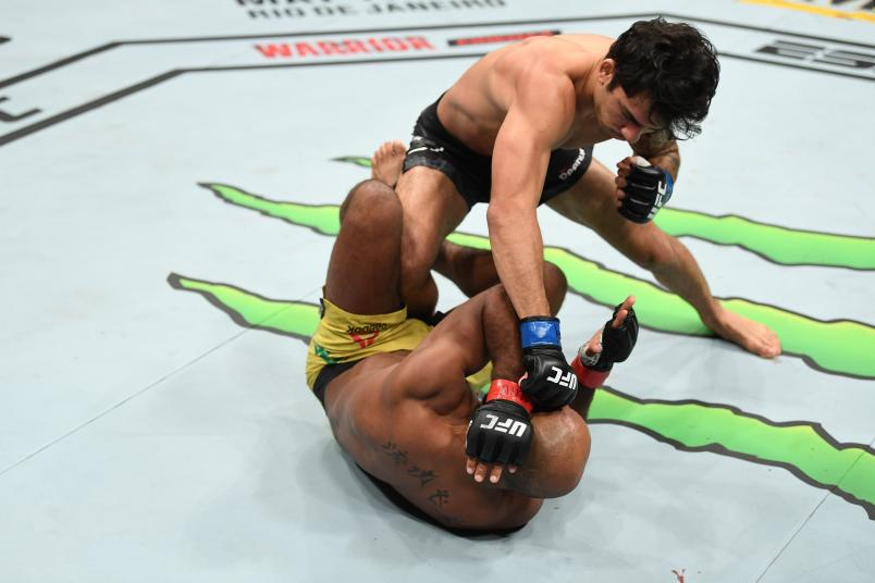 Alexandre Pantoja of Brazil punches Wilson Reis of Brazil in their flyweight bout during the UFC 236 event at State Farm Arena on April 13, 2019 in Atlanta, Georgia. (Photo by Josh Hedges/Zuffa LLC/Zuffa LLC via Getty Images)