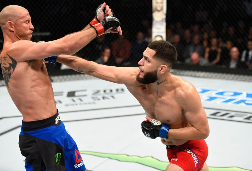 DENVER, CO - JANUARY 28: (R-L) Jorge Masvidal punches Donald Cerrone in their welterweight bout during the UFC Fight Night event at the Pepsi Center on January 28, 2017 in Denver, Colorado. (Photo by Josh Hedges/Zuffa LLC/Zuffa LLC via Getty Images)