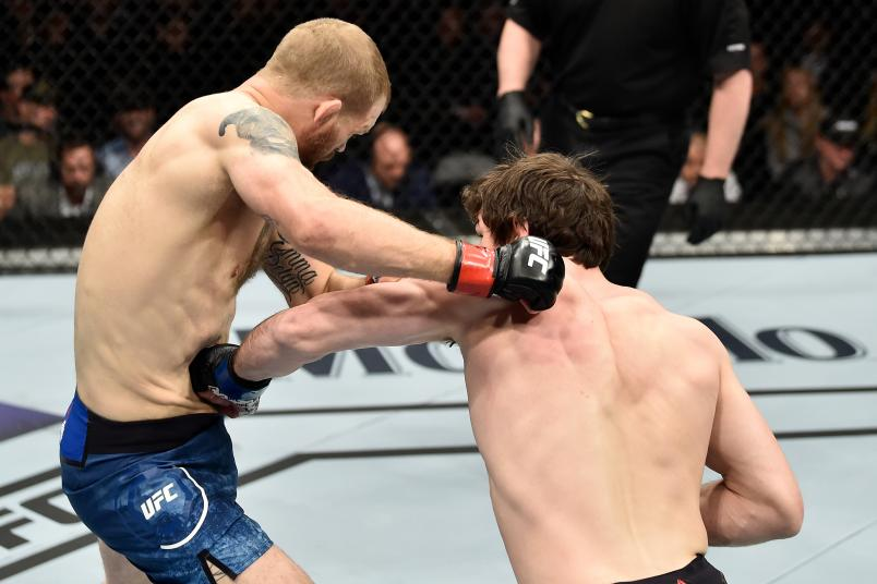 Olivier Aubin-Mercier of Canada punches the body of Evan Dunham in their lightweight bout during the UFC 223 event inside Barclays Center on April 7, 2018 in Brooklyn, New York. (Photo by Jeff Bottari/Zuffa LLC/Zuffa LLC via Getty Images)