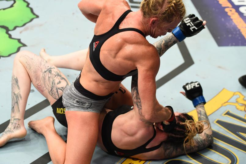 CHICAGO, ILLINOIS - JUNE 09: (R-L) Holly Holm punches Megan Anderson of Australia in their women's featherweight fight during the UFC 225 event at the United Center on June 9, 2018 in Chicago, Illinois. (Photo by Josh Hedges/Zuffa LLC/Zuffa LLC via Getty Images)