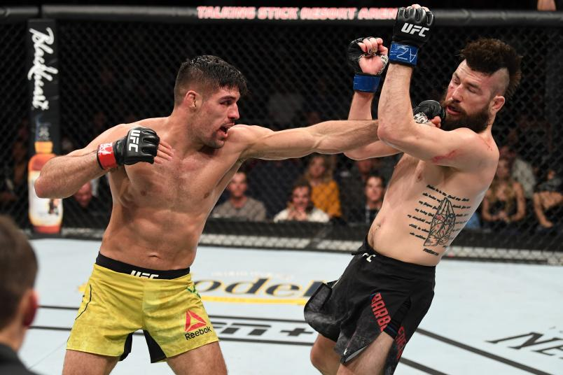 Vicente Luque punches Bryan Barberena in their welterweight bout during the UFC Fight Night event at Talking Stick Resort Arena on February 17, 2019 in Phoenix, Arizona. (Photo by Josh Hedges/Zuffa LLC via Getty Images)