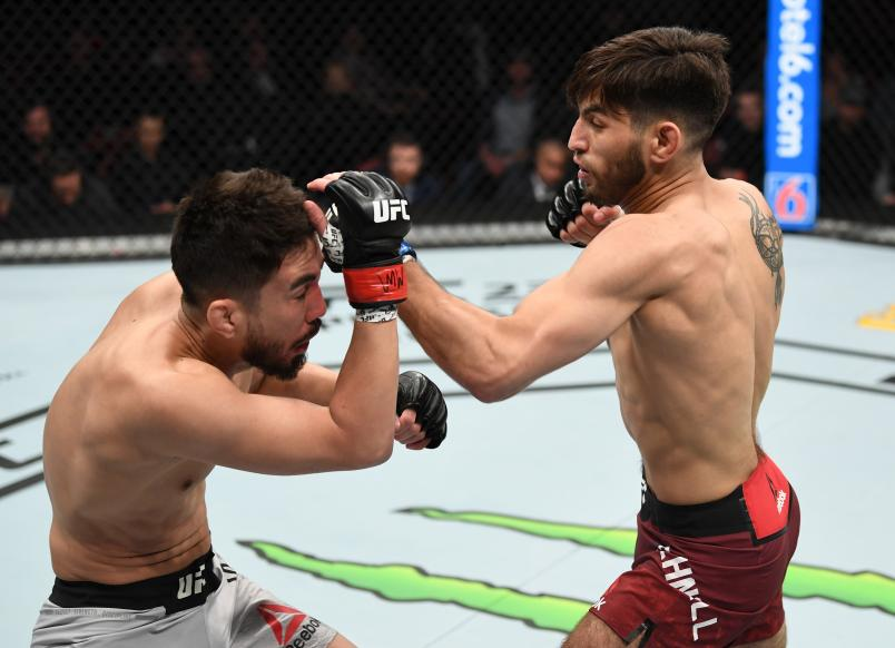 WICHITA, KS - MARCH 09: (R-L) Matt Schnell punches Louis Smolka in their bantamweight bout during the UFC Fight Night event at Intrust Bank Arena on March 9, 2019 in Wichita, Kansas. (Photo by Josh Hedges/Zuffa LLC/Zuffa LLC via Getty Images)