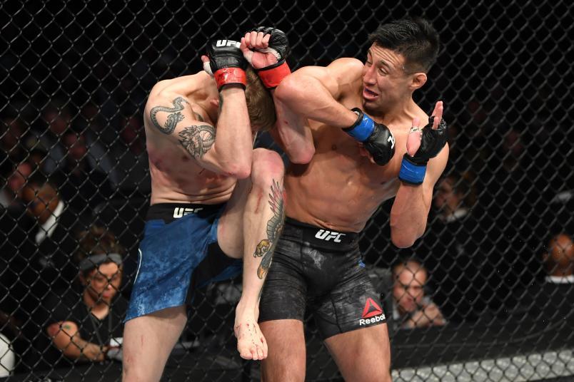 NASHVILLE, TENNESSEE - MARCH 23: (R-L) Chris Gutierrez elbows Ryan MacDonald in their bantamweight bout during the UFC Fight Night event at Bridgestone Arena on March 23, 2019 in Nashville, Tennessee. (Photo by Jeff Bottari/Zuffa LLC/Zuffa LLC via Getty Images)