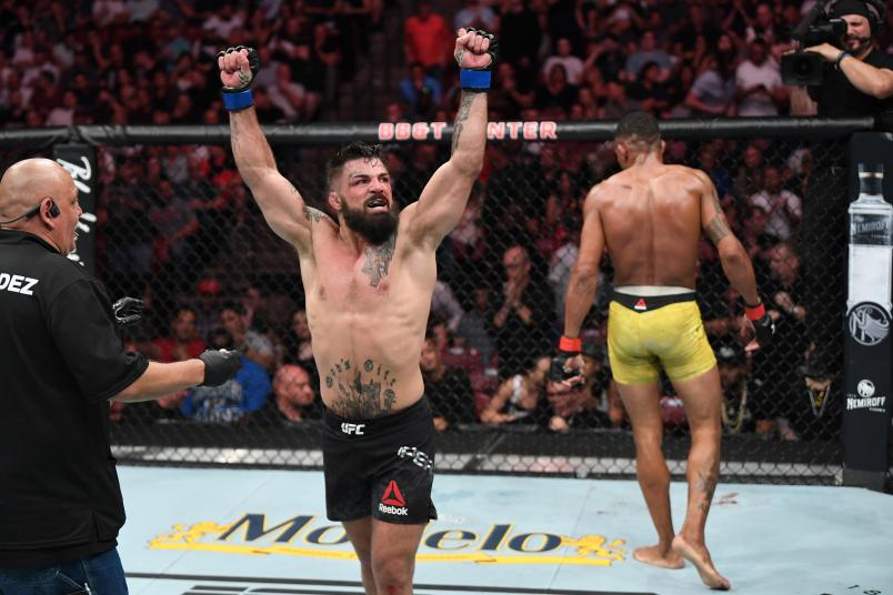 SUNRISE, FL - APRIL 27: (L-R) Mike Perry reacts after the conclusion of his welterweight bout against Alex Oliveira of Brazil during the UFC Fight Night event at BB&T Center on April 27, 2019 in Sunrise, Florida. (Photo by Jeff Bottari/Zuffa LLC)