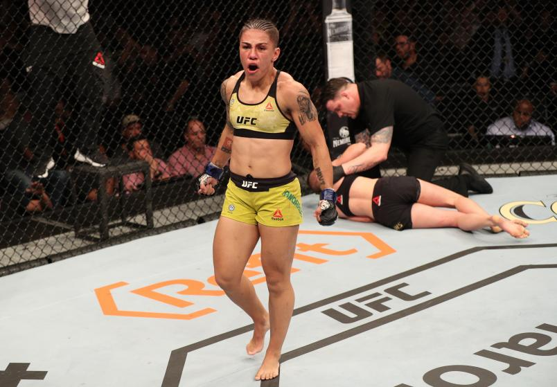 Jessica Andrade of Brazil celebrates after her knockout victory over Rose Namajunas in their women's strawweight championship bout during the UFC 237 event at Jeunesse Arena on May 11, 2019 in Rio De Janeiro, Brazil. (Photo by Buda Mendes/Zuffa LLC)