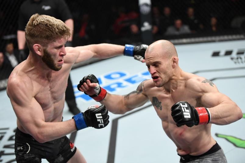 OTTAWA, ON - MAY 04: (L-R) Cole Smith of Canada punches Mitch Gagnon of Canada in their bantamweight bout during the UFC Fight Night event at Canadian Tire Centre on May 4, 2019 in Ottawa, Ontario, Canada. (Photo by Jeff Bottari/Zuffa LLC)