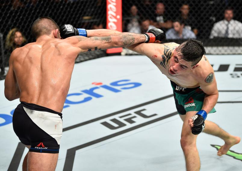 MEXICO CITY, MEXICO - AUGUST 05: (R-L) Sergio Pettis exchanges punches with Brandon Moreno of Mexico in their flyweight bout during the UFC Fight Night event at Arena Ciudad de Mexico on August 5, 2017 in Mexico City, Mexico. (Photo by Jeff Bottari/Zuffa LLC/Zuffa LLC via Getty Images)