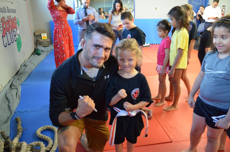 UFC Fighter Randy Costa poses with a young fan