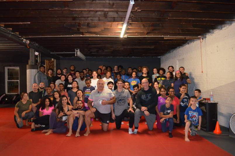 UFC Fighter Charles Rosa poses with students at Level Ground MMA