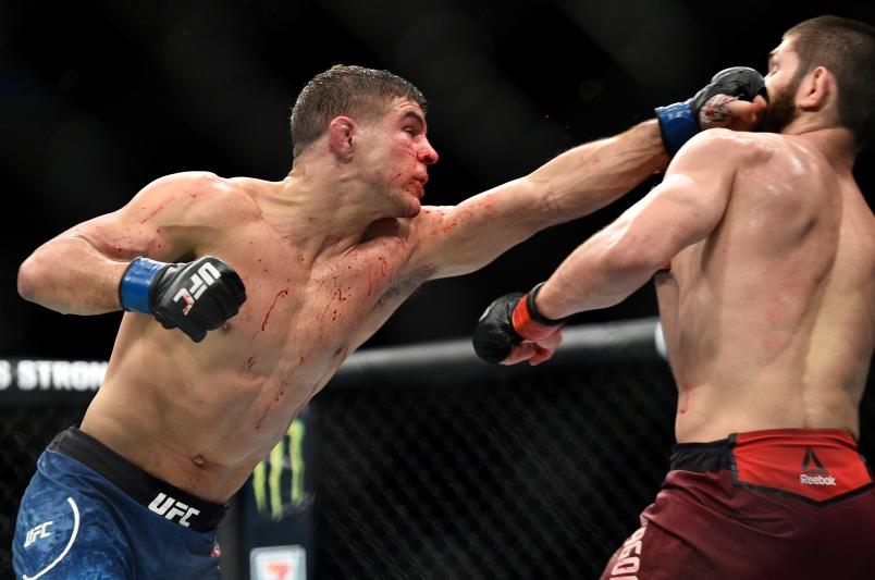 BROOKLYN, NEW YORK - APRIL 07: (L-R) Al Iaquinta punches Khabib Nurmagomedov of Russia in their lightweight title bout during the UFC 223 event inside Barclays Center on April 7, 2018 in Brooklyn, New York. (Photo by Brandon Magnus/Zuffa LLC/Zuffa LLC via Getty Images)