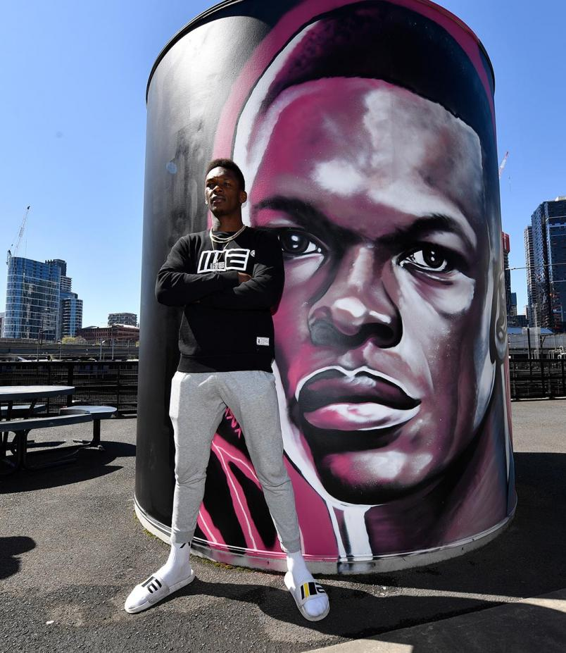 Israel Adesanya Poses Next To His Marvel Stadium Mural (Photo by Jeff Bottari/Zuffa LLC)