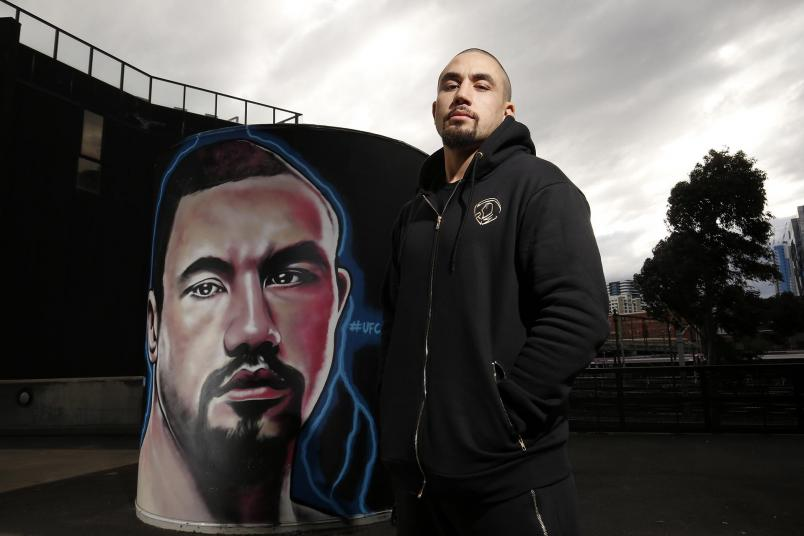 Robert Whittaker In Front of His Marvel Stadium Mural  (Photo by Darrian Traynor for Zuffa LLC)