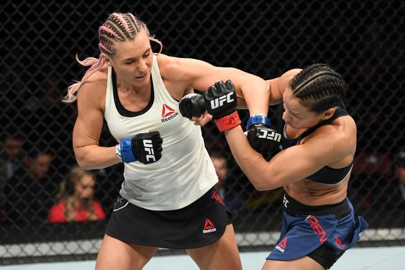 Yana Kunitskaya of Russia punches Marion Reneau in their women's bantamweight bout during the UFC Fight Night event at Intrust Bank Arena on March 9, 2019 in Wichita, Kansas. (Photo by Josh Hedges/Zuffa LLC via Getty Images)