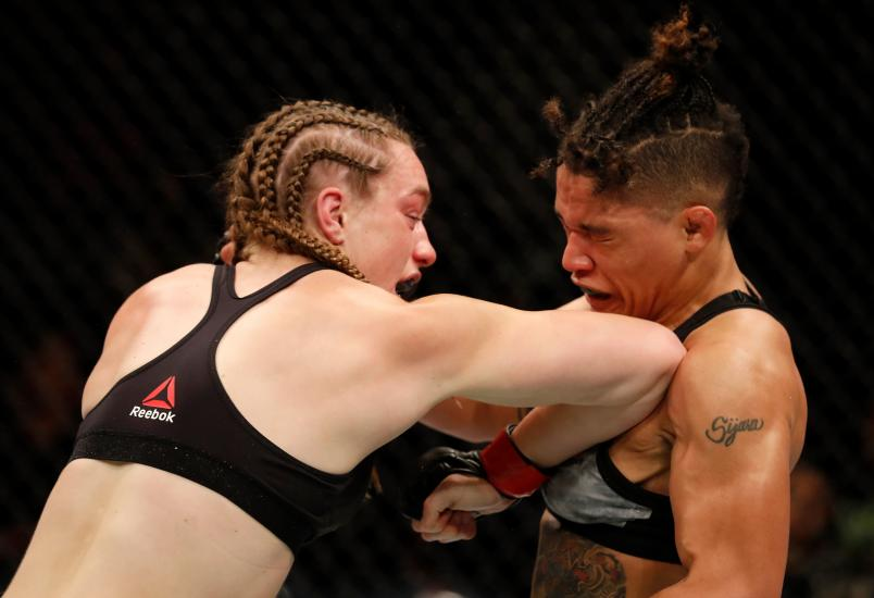 Aspen Ladd elbows Sijara Eubanks in their women's bantamweight bout during the UFC Fight Night event at Blue Cross Arena on May 18, 2019 in Rochester, New York. (Photo by Michael Owens/Zuffa LLC via Getty Images)