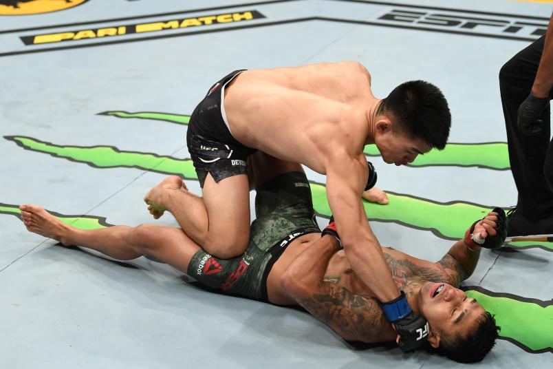 Song Yadong of China finishes Alejandro Perez of Mexico in their bantamweight fight during the UFC 239 event at T-Mobile Arena on July 6, 2019 in Las Vegas, Nevada. (Photo by Josh Hedges/Zuffa LLC)