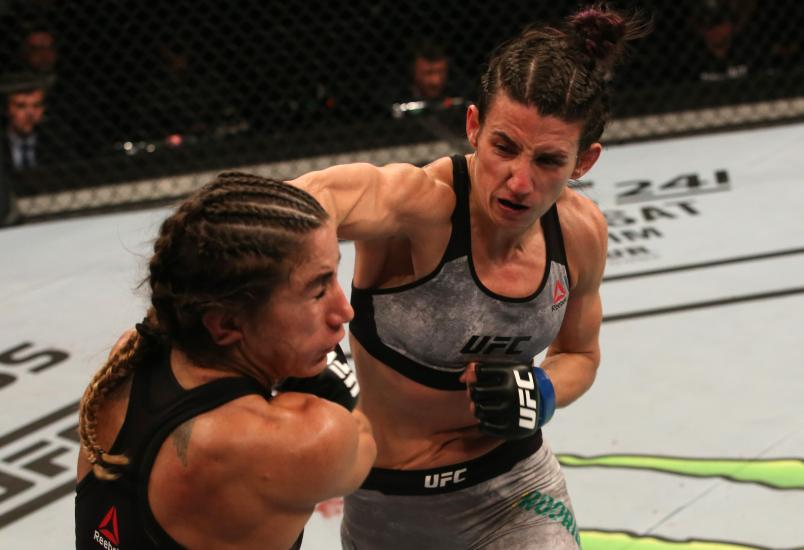 Marina Rodriguez of Brazil punches Tecia Torres in their strawweight fight during the UFC Fight Night event at Antel Arena on August 10, 2019 in Montevideo, Uruguay. (Photo by Alexandre Schneider/Zuffa LLC)
