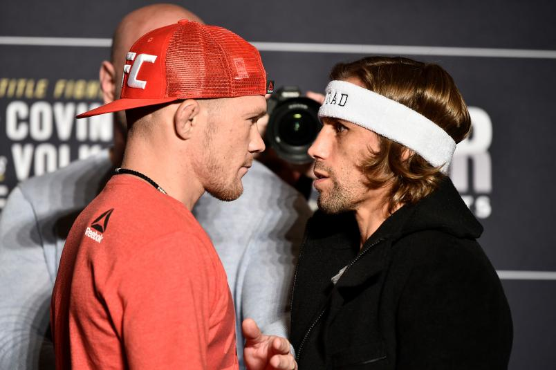 Petr Yan of Russia and Urijah Faber face off during the UFC 245 Ultimate Media Day at the Red Rock Casino Resort on December 12, 2019 in Las Vegas, Nevada. (Photo by Chris Unger/Zuffa LLC via Getty Images)