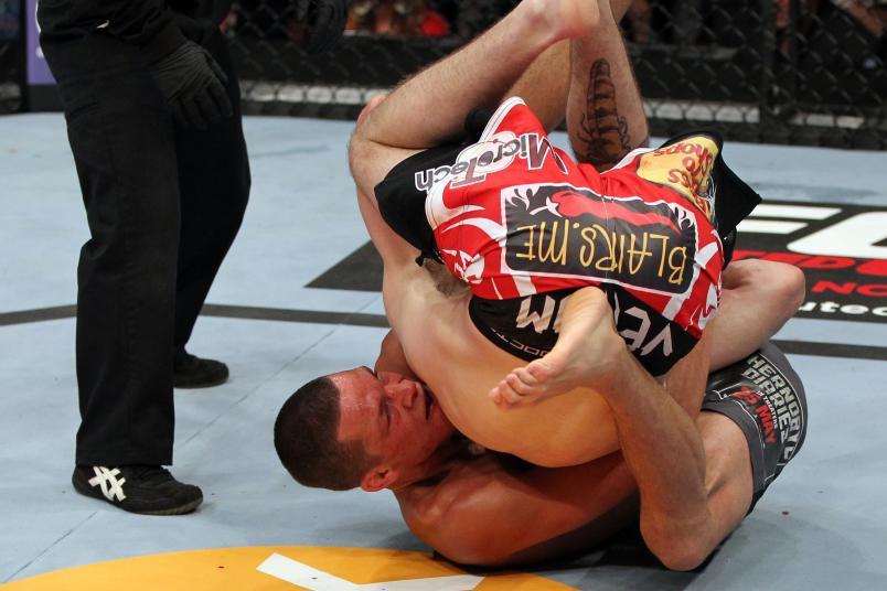 EAST RUTHERFORD, NJ - MAY 05: Nate Diaz Takes down Jim Miller during their Lightweight bout at Izod Center on May 5, 2012 in East Rutherford, New Jersey. (Photo by Josh Hedges/Zuffa LLC/Zuffa LLC via Getty Images)