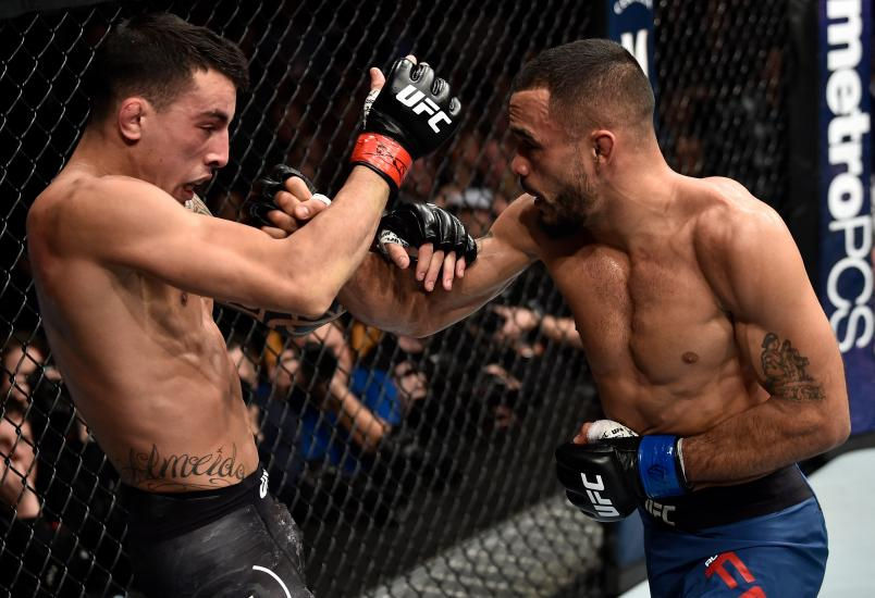 Rob Font punches Thomas Almeida of Brazil in their bantamweight bout during the UFC 220 event at TD Garden on January 20, 2018 in Boston, Massachusetts. (Photo by Jeff Bottari/Zuffa LLC via Getty Images)