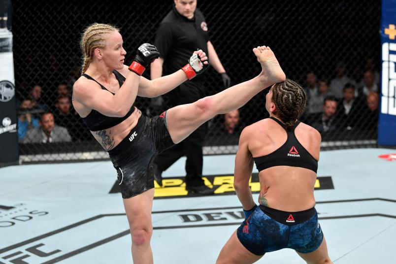 CHICAGO, IL - JUNE 08: (L-R) Valentina Shevchenko of Kyrgyzstan knocks out Jessica Eye in their women's flyweight championship bout during the UFC 238 event at the United Center on June 8, 2019 in Chicago, Illinois. (Photo by Jeff Bottari/Zuffa LLC)