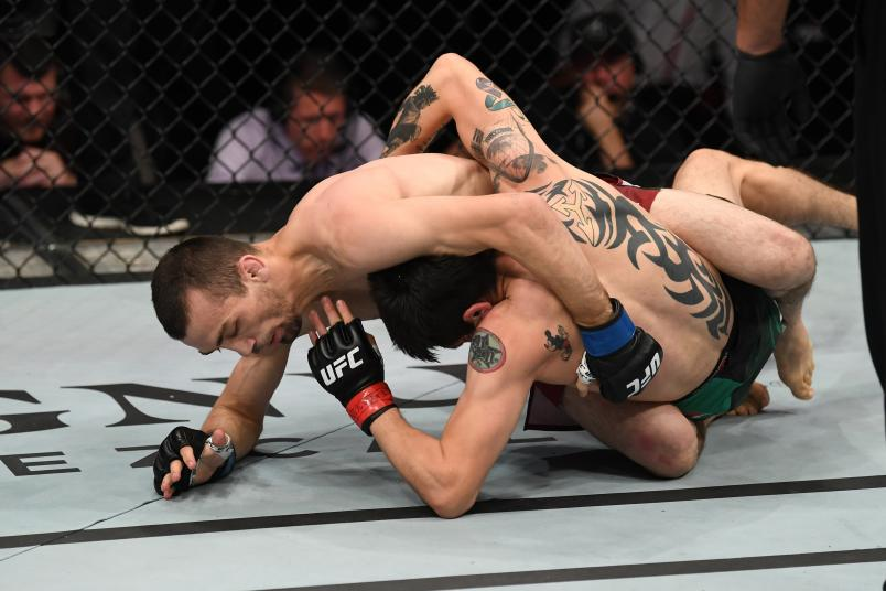 MEXICO CITY, MEXICO - SEPTEMBER 21: (L-R) Askar Askarov of Russia and Brandon Moreno of Mexico grapple in their flyweight bout during the UFC Fight Night event on September 21, 2019 in Mexico City, Mexico. (Photo by Josh Hedges/Zuffa LLC/Zuffa LLC via Getty Images)