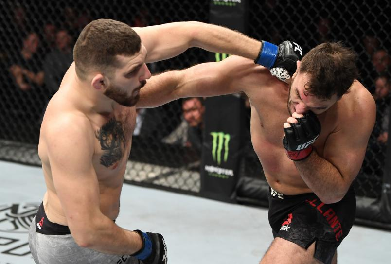 PRAGUE, CZECH REPUBLIC - FEBRUARY 23: (L-R) Michal Oleksiejczuk of Poland punches Gian Villante in their light heavyweight bout during the UFC Fight Night event at O2 Arena on February 23, 2019 in the Prague, Czech Republic. (Photo by Jeff Bottari/Zuffa LLC/Zuffa LLC via Getty Images)