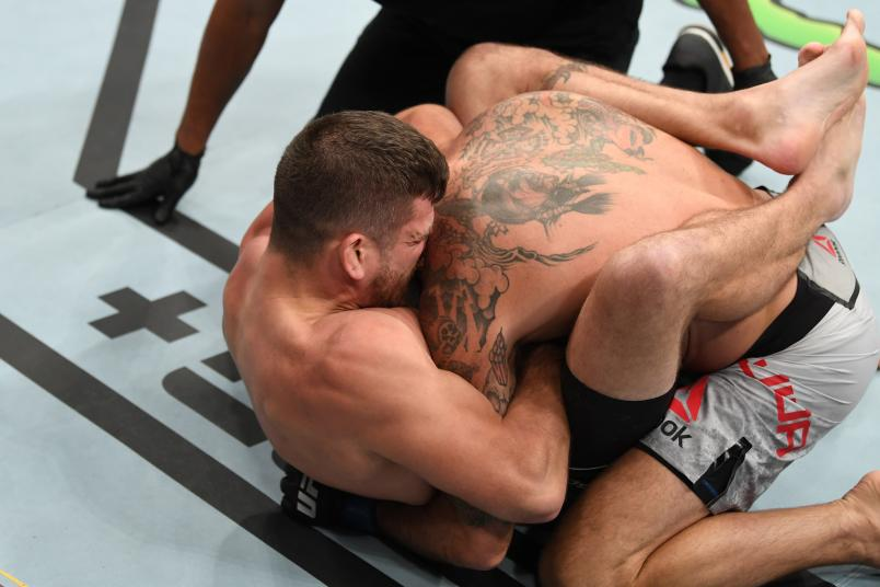 NEWARK, NJ - AUGUST 03: (L-R) Jim Miller submits Clay Guida in their lightweight bout during the UFC Fight Night event at the Prudential Center on August 3, 2019 in Newark, New Jersey. (Photo by Josh Hedges/Zuffa LLC)