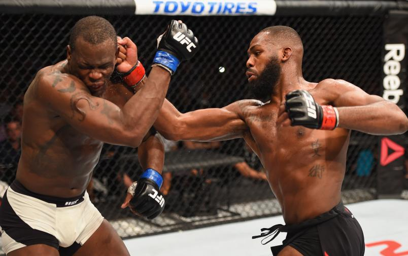 Jon Jones punches Ovince Saint Preux in their interim UFC light heavyweight championship bout during the UFC 197 event inside MGM Grand Garden Arena on April 23, 2016 in Las Vegas, Nevada. (Photo by Josh Hedges/Zuffa LLC via Getty Images)