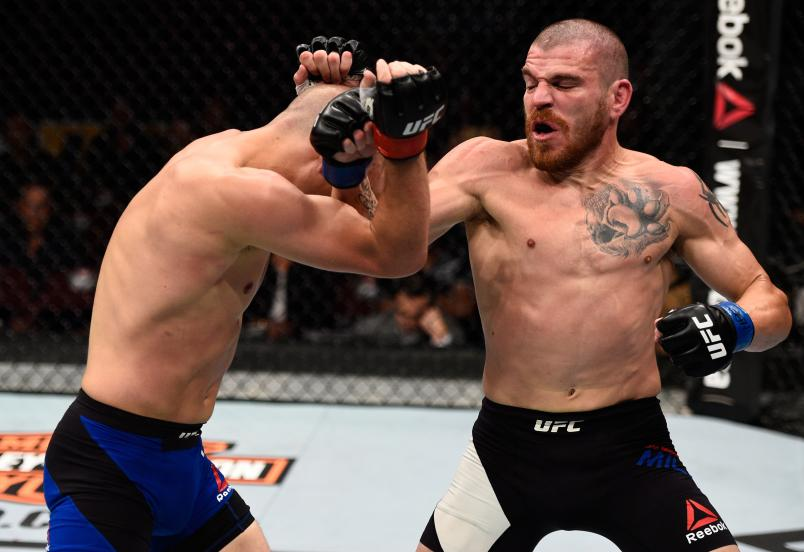 VANCOUVER, BC - AUGUST 27: (R-L) Jim Miller of the United States punches Joe Lauzon of the United States in their lightweight bout during the UFC Fight Night event at Rogers Arena on August 27, 2016 in Vancouver, British Columbia, Canada. (Photo by Jeff Bottari/Zuffa LLC)