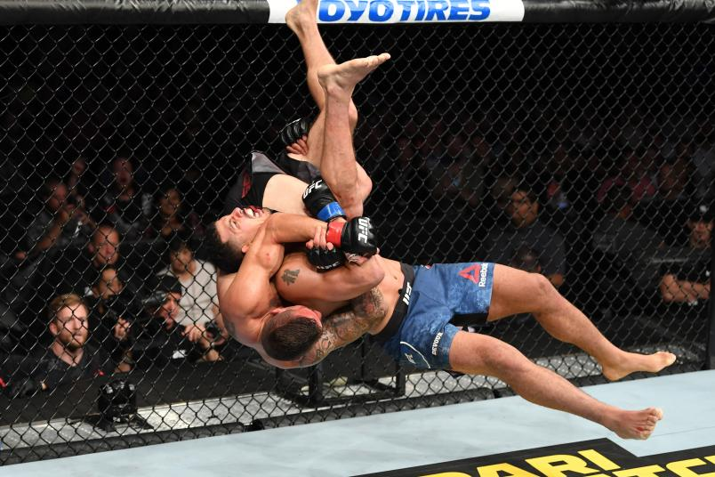 ANAHEIM, CALIFORNIA - AUGUST 17: (R-L) Drakkar Klose slams Christos Giagos in their lightweight bout during the UFC 241 event at the Honda Center on August 17, 2019 in Anaheim, California. (Photo by Josh Hedges/Zuffa LLC/Zuffa LLC via Getty Images)