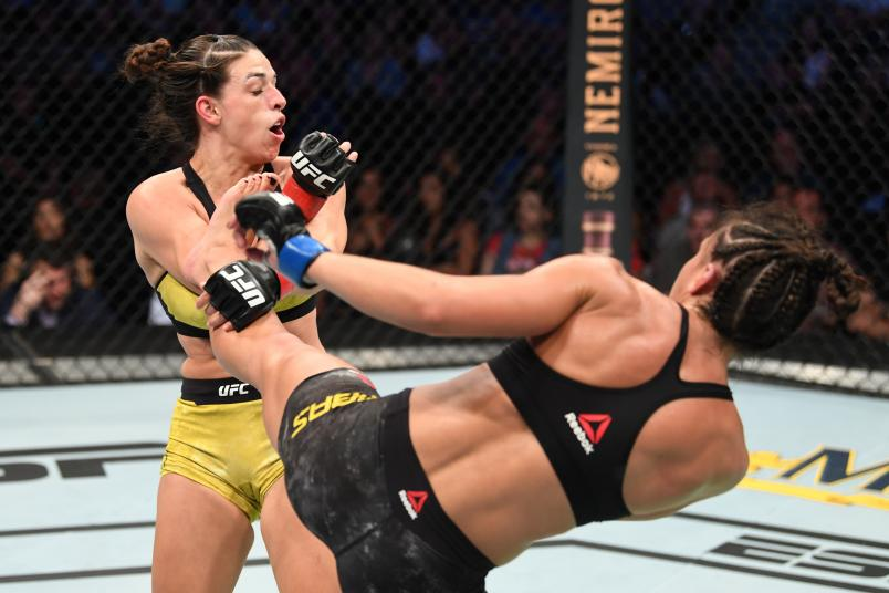 TAMPA, FLORIDA - OCTOBER 12: (R-L) Amanda Ribas of Brazil kicks Mackenzie Dern in their women's strawweight bout during the UFC Fight Night event at Amalie Arena on October 12, 2019 in Tampa, Florida. (Photo by Josh Hedges/Zuffa LLC via Getty Images)