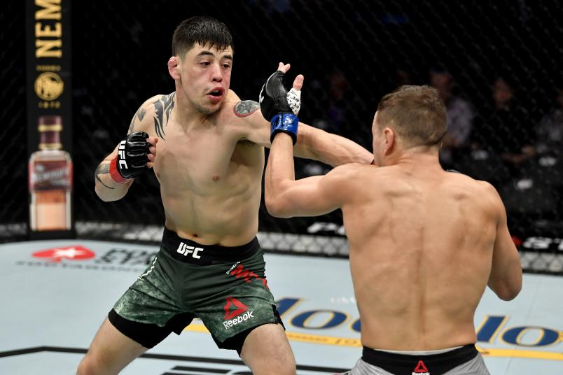 LAS VEGAS, NEVADA - DECEMBER 14: (L-R) Brandon Moreno strikes Kai Kara-France of New Zealand in their flyweight bout during the UFC 245 event at T-Mobile Arena on December 14, 2019 in Las Vegas, Nevada. (Photo by Jeff Bottari/Zuffa LLC)