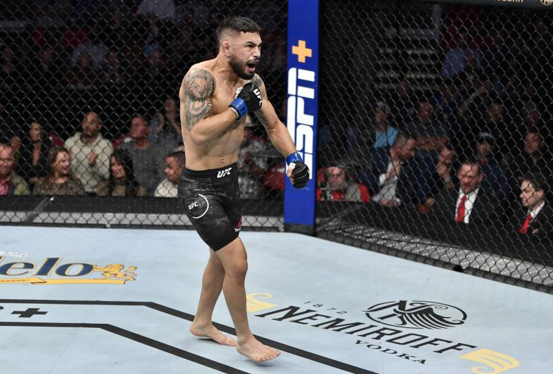 RALEIGH, NORTH CAROLINA - JANUARY 25: Alex Perez celebrates after his submission victory over Jordan Espinosa in their flyweight fight during the UFC Fight Night event at PNC Arena on January 25, 2020 in Raleigh, North Carolina. (Photo by Jeff Bottari/Zuffa LLC via Getty Images)