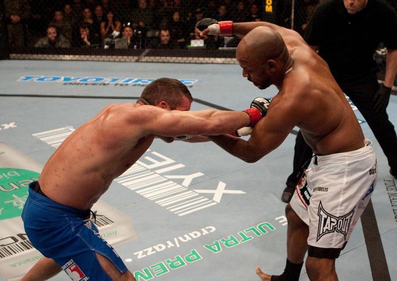 MIRAMAR, CA - DECEMBER 13: (L-R) Marcus Davis punches Shonie Carter at UFC Fight Night 7 at the Marine Corps Air Station Miramar on December 13, 2006 in Miramar, California. (Photo by Josh Hedges/Zuffa LLC/Zuffa LLC via Getty Images)
