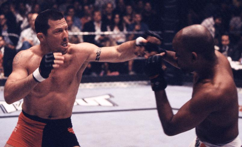 EAST RUTHERFORD, NJ - JUNE 29: (L-R) Pat Miletich punches Shonie Carter during their bout at UFC 32 on June 29, 2001 in East Rutherford, New Jersey. (Photo by Zuffa LLC/Zuffa LLC via Getty Images)