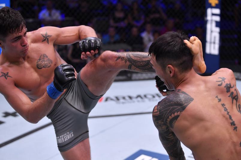 LAS VEGAS, NEVADA - AUGUST 27: (L-R) Peter Barrett kicks Sanghoon Yoo in their lightweight bout during Dana White's Contender Series season three week 10 at the UFC Apex on August 27, 2019 in Las Vegas, Nevada. (Photo by Jeff Bottari/DWCS LLC/Zuffa LLC)