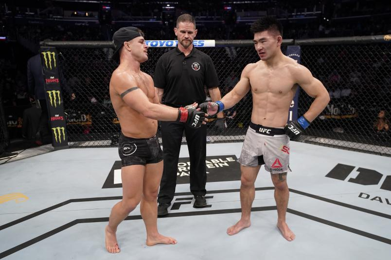WASHINGTON, DC - DECEMBER 07: (L-R) Cody Stamann and Song Yadong of China react after their bantamweight bout is ruled a majority draw during the UFC Fight Night event at Capital One Arena on December 07, 2019 in Washington, DC. (Photo by Jeff Bottari/Zuffa LLC via Getty Images)